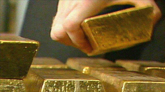 Stacking gold bars