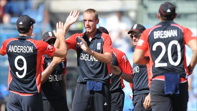 Stuart Broad (centre) takes congratulations from his England team-mates
