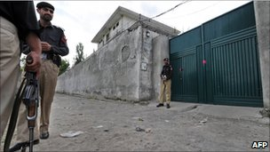 Pakistani policemen stand guard outside the hideout house of slain Al-Qaeda leader Osama bin Laden in Abbottabad on May 5, 2011.