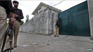 Pakistani policemen stand guard outside the hideout house of slain Al-Qaeda leader Osama bin Laden in Abbottabad on May 5, 2011.