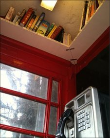 Red phone box in Horsley turned into library (UK)