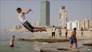 Libyans enjoy a day on a beach in Tripoli, Libya, Tuesday 3 May 2011