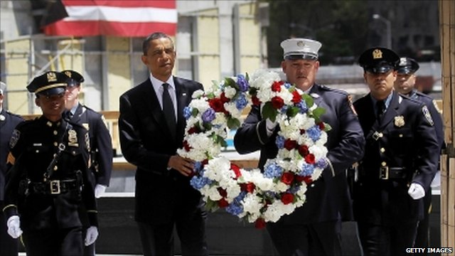 President Obama and a policeman with wreath