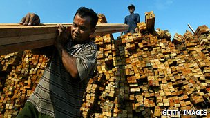 Hardwood being offloaded in Indonesia