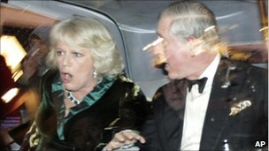 Prince Charles and Camilla, Duchess of Cornwall react as their car is attacked during the student protests