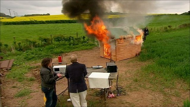 Richard Hammond and Paul Mitcheson watch a shed burning