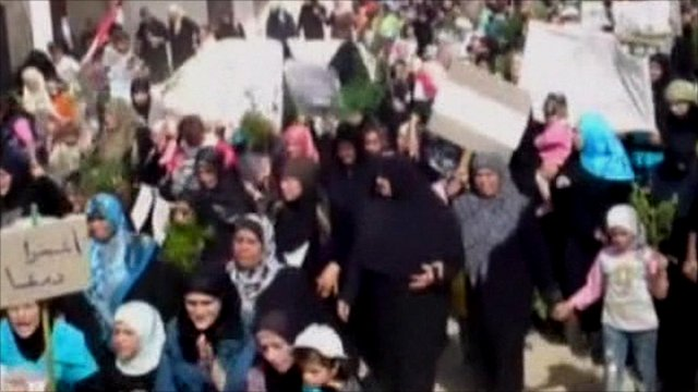 Women and children in Syria protesting