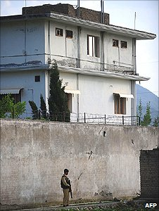 A Pakistani Army soldier stands guard outside bin Laden's compound
