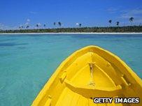 Yellow boat on ocean