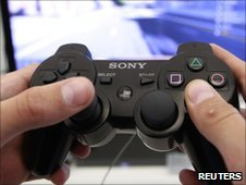 A person plays a video game at a Sony Playstation in Sony store in Berlin