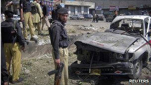 Police stand at the scene of a suicide bomb blast in Dir, north-western Pakistan. Photo: April 2011