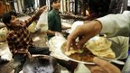 Street vendors serve food in Delhi