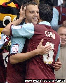 Burnley's Jay Rodriguez celebrates scoring with Jack Cork