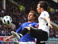 Everton's Phil Jagielka tackles David Silva