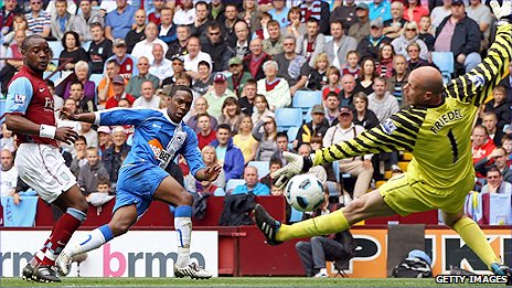 Wigan midfielder Charles N'Zogbia (centre) slots past Aston Villa keeper Brad Friedel