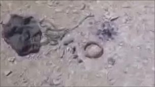 Grab from amateur footage showing a mine dropped by parachute in Misrata, May 2011