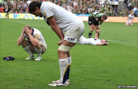 Leeds players are visibly deflated after their defeat by Northampton