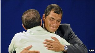 Ecuadorean President Rafael Correa (R) embraces Ecuadorean Minister of Foreign Affairs Ricardo Patino