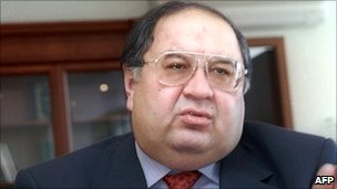 File picture taken 19 December 2001 shows Russian steel tycoon Alisher Usmanov as he gives an interview in his office in Moscow.