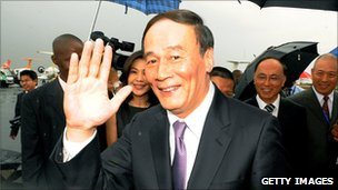 Chinese Vice-Premier Wang Qishan waves to reporters in Nairobi