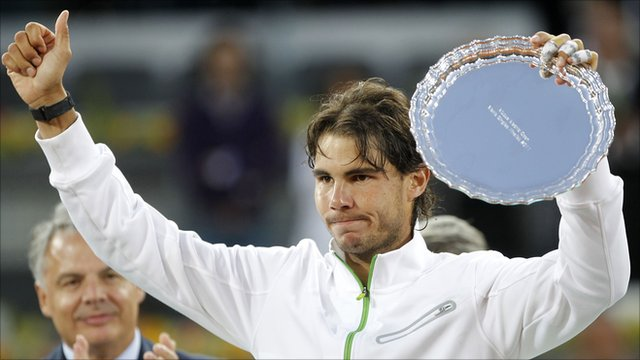 Rafael Nadal of Spain holds up his second-place Madrid Open trophy