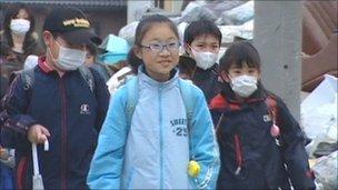 Children head to school in Ishinomaki, Japan