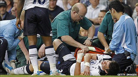 Tottenham winger Gareth Bale receives treatment before being substituted against Blackpool after a tackle by Charlie Adam