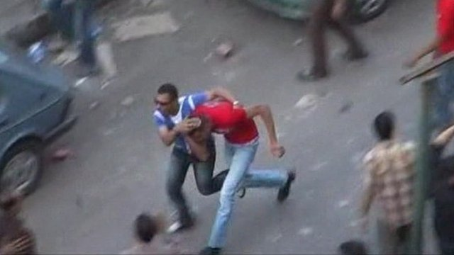 Two men run through Cairo
