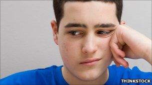 Teenage boy thinking