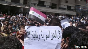 "Banner saying ""Are all Syrian towns terrorist?"" at an anti-government protest in Baniyas (6 May 2011)"
