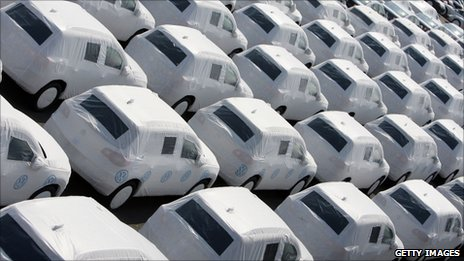 New VW cars, covered with white protection sheets, wait to get loaded onto transport ships at the Volkswagen car factory Emden on April 24, 2009 in Emden, Germany.