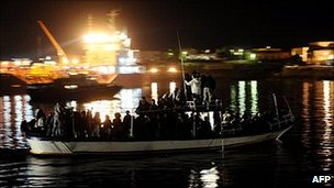 A boat from Tunisia arriving in Lampedusa, 10 April 2011