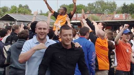 Barnet supporters celebrate their League Two survival