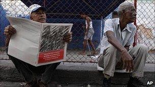 Man reads new economic guidelines in Havana, Cuba. 9 May 2011
