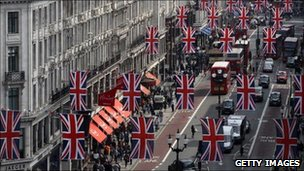 Shoppers on Regents Street under union jack bunting for the royal wedding