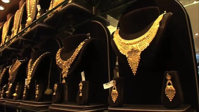 Gold necklaces on display