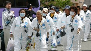 Residents of Kawauchi village inside the no-go zone head home to collect their belongings