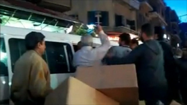 Protesters being bundled into a van