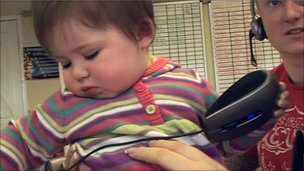 Baby Grace plays with mouse