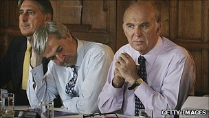 Chris Huhne (middle) and Vince Cable (right)