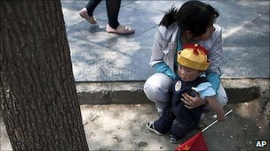 Chinese woman with child in Beijing (file image)