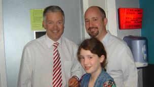Derek Brockway with Erin and Mark Moran