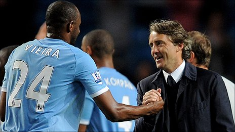 Manchester City boss Roberto Mancini (right) enjoys the win over Tottenham with midfielder Patrick Vieira