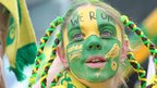 Norwich City fan celebrates during the club's Premier League promotion party