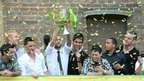 Norwich City players celebrate during their Premier League promotion party
