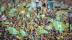 Norwich City fans celebrate outside City Hall as the players attend a civic reception