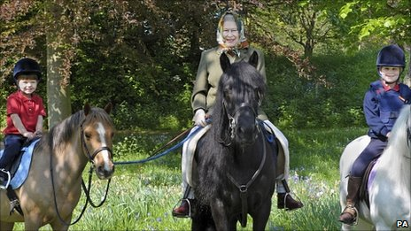 Queen riding in Windsor Great Park with her two youngest grandchildren