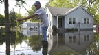 Man measuring water level outside his house in Memphis, Tennessee
