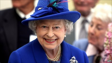 Queen Elizabeth II smiles as she visits the Newmarket Day Centre on 3 May 2011