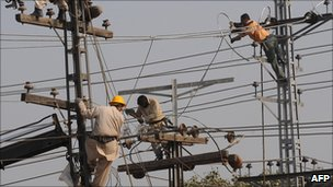 Men working on electricity pylons